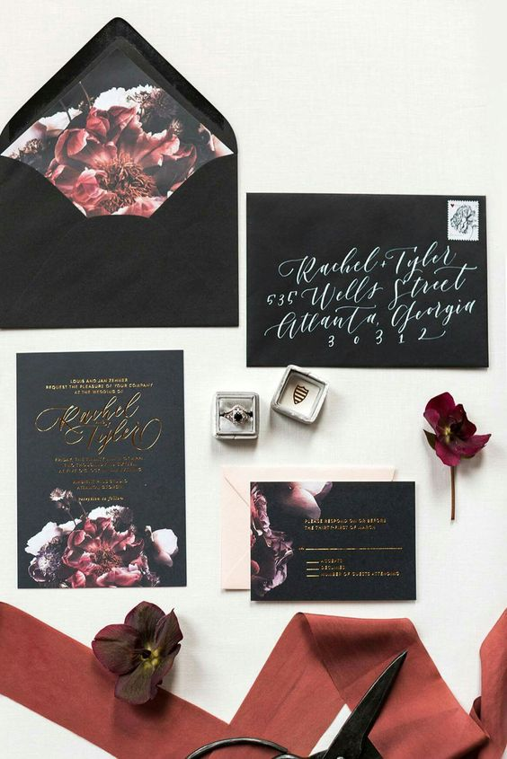 a dramatic black and burgundy wedding invitation suite with floral lining and calligraphy for Halloween