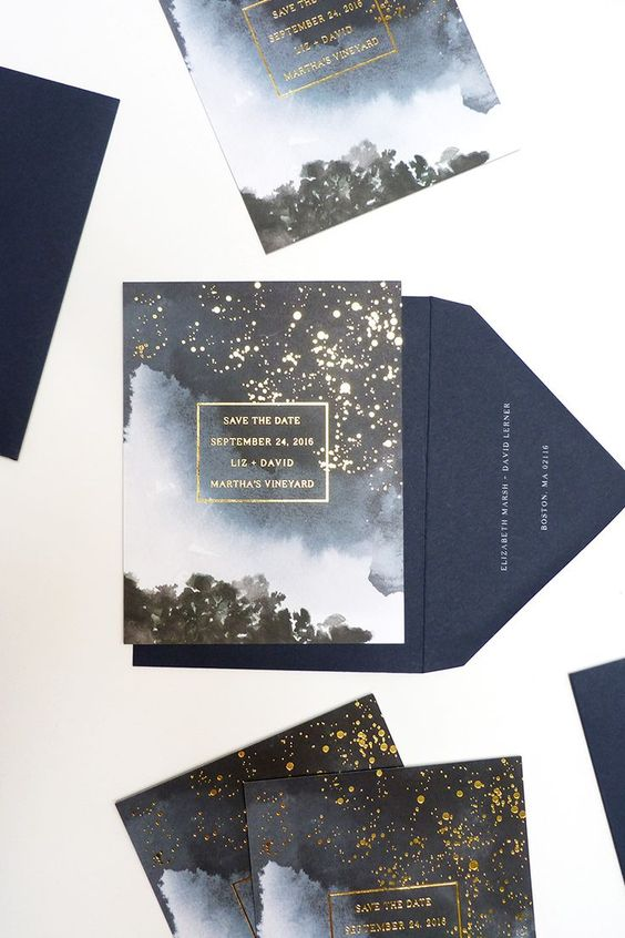 a galaxy-inspired wedding invitation suite with gold flecks that show stars