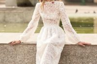 09 a lace and lace applique midi wedding dress with sleeves and an accented waist