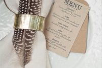 09 add a feather and a metallic napkin ring to make the place setting cooler