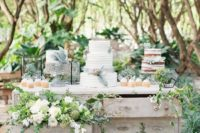 09 an outdoor dessert table decorated with greenery and blooms for an intimate garden wedding
