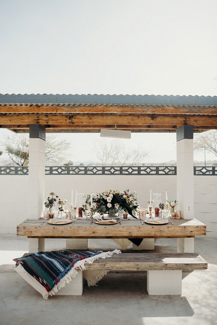 The space itself was a roofed terrace with benches and a table, the benches were covered with boho rugs
