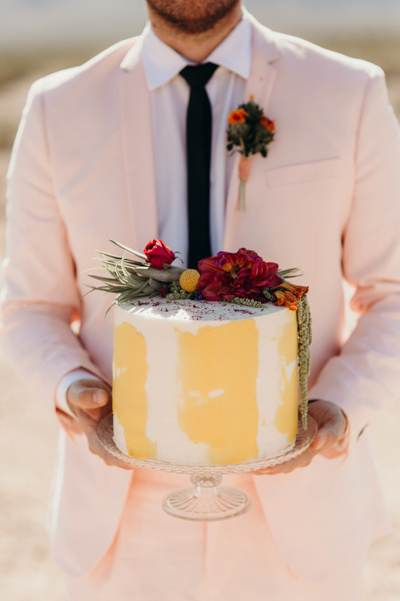 The wedding cake was a buttercream one in yellow and white topped with bold blooms