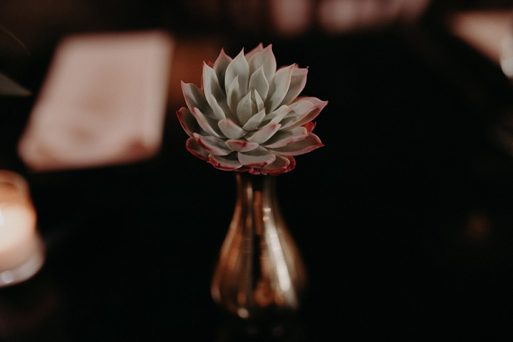 The wedding centerpieces were done with succulents and bright blooms in mercury glass vases
