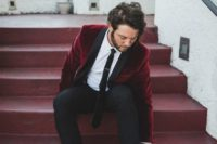 10 a chic groom's look with black pants and moccasins, a burgundy velvet blazer with black lapels and a black tie