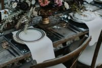 10 a lush haunted wedding centerpiece with black, white and blush flowers plus textural greenery and willow