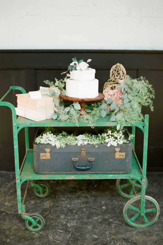 a vintage trolley may be a cool take on a usual table and it will bring a vintage feel to the space