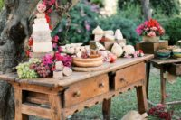 10 an outdoor dessert, fruit and cheese table decorated with lush and bright florals
