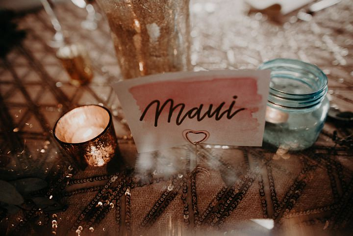 The tables were dressed up with sequin tablecloths, candles and watercolor table names
