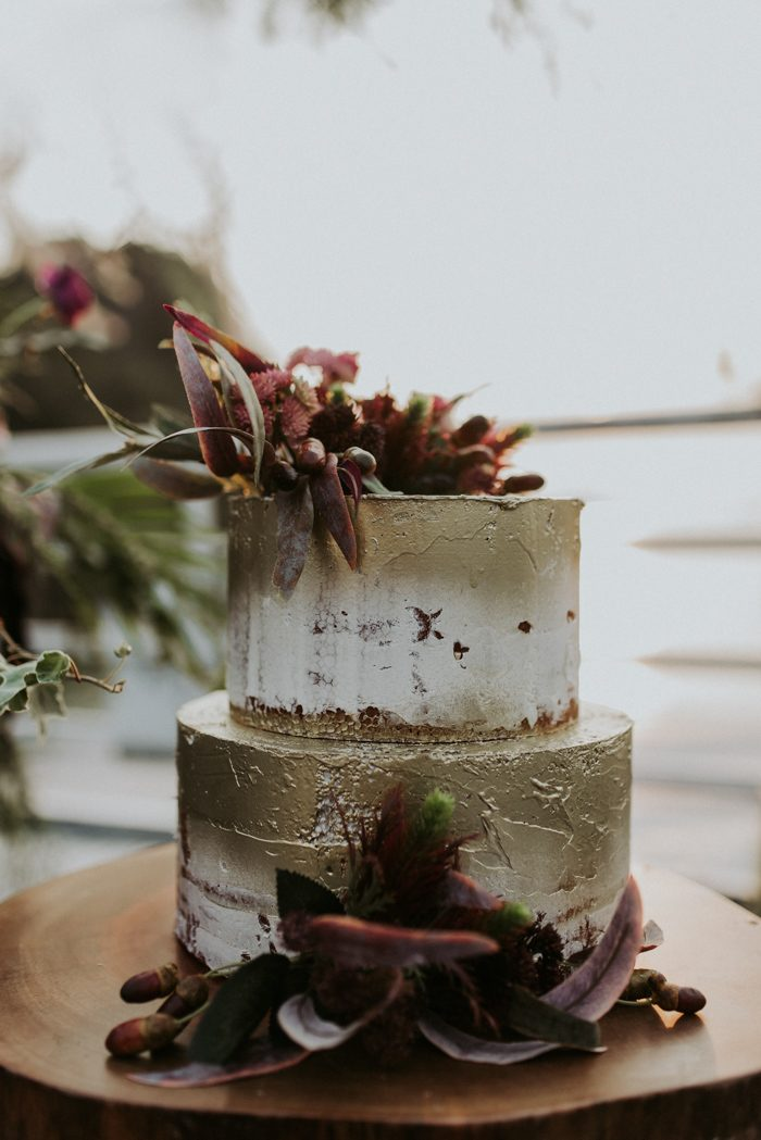 The wedding cake was a buttercream one with white and gold plus bold blooms