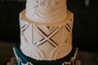 11 The wedding cake was an art deco one, with a floral, geometric and embellished tier