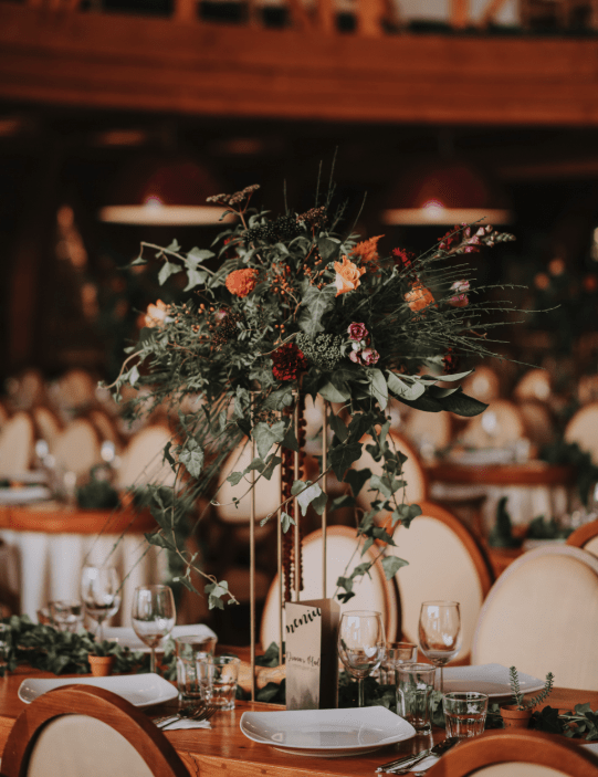 The wedding centerpieces were textural tall ones with fall-colored blooms and berries
