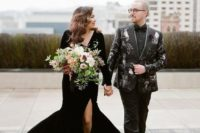 11 a black wedding suit printed with owls, black shoes and a black shirt plus a bow tie