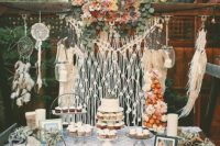 11 a boho-themed dessert table decorated with macrame, macrame dream catchers and a lace runner