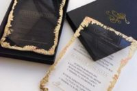 11 a modern wedding invitation suite in navy and with acrylic invites with a gold foil edge