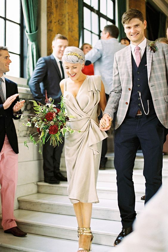 an unusual grey draped midi wedding dress plus metallic shoes for a fashion statement