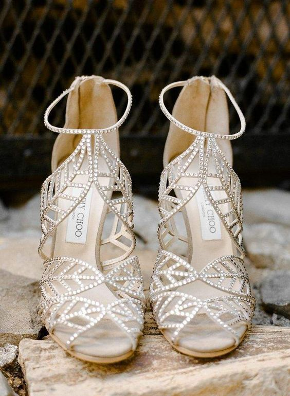fully embellished strappy heels with leaf parts look wow and strike at once
