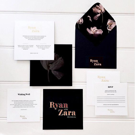 a modern dark floral invitation suite in black and white, with copper touches and a strong wow effect