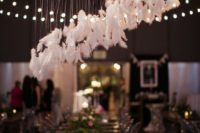 12 an airy feather hanging over the sweetheart table is a great touch to a boho reception