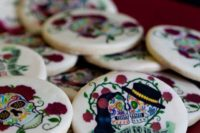12 hand painted sugar skull wedding cookies is atasty favor idea and a delicious dessert