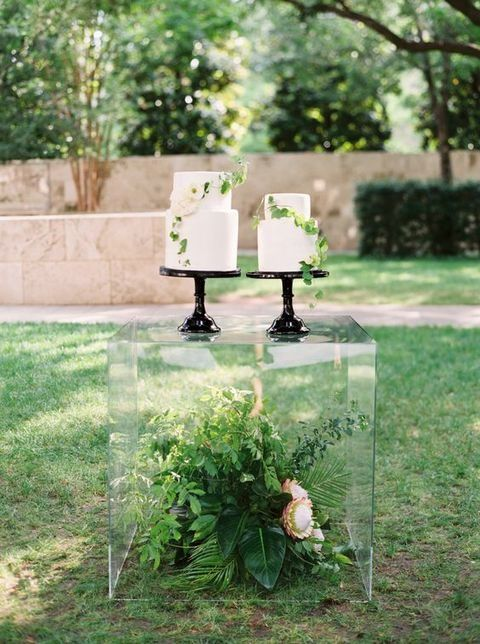 if you are having a modern or minimalist wedding, why not go for an acrylic cube instead of a usual cake table