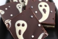 13 Halloween ghost chocolate bark is a fun and whimsy idea, which can be DIYed