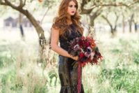 13 a black sequin mermaid wedding dress with a lace bodice and a burgundy and black wedding bouquet