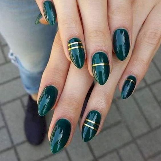 emerald nails with gold stripes are a great idea for the fall, make a statement with this elegant and bold color