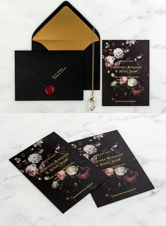 striking moody wedding stationery with dark florals, gold foil lining and touches of gold