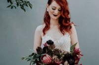 14 a burgundy and black wedding bouquet with greenery and a matching dark bridal lip