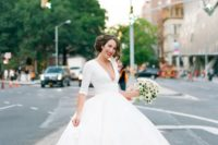 14 a chic midi wedding dress with long sleeves and a plunging neckline plus cutout wedding shoes