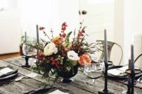 14 a textural centerpiece with orange, red and white blooms, greenery and herbs for a simple moody look