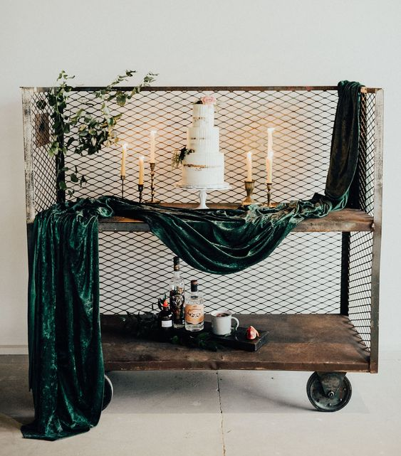 a unique cake table idea - a vintage trolley with a touch of greenery and grene velvet