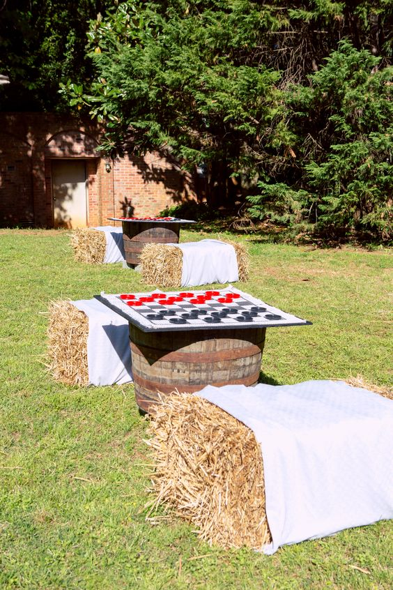 checkers and chess as gardne games and hay bales as chairs