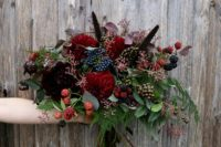 15 a burgundy and dark purple bouquet with black and navy touches for a moody bride