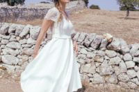 15 a chic midi wedding gown with a lace bodice with short sleeves and a V-neckline and a plain skirt plus metallic shoes