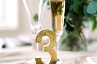 15 a gold foil table number is a chic and glam idea for any wedding