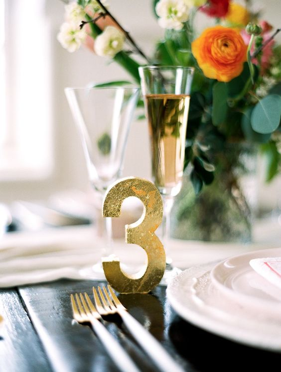a gold foil table number is a chic and glam idea for any wedding