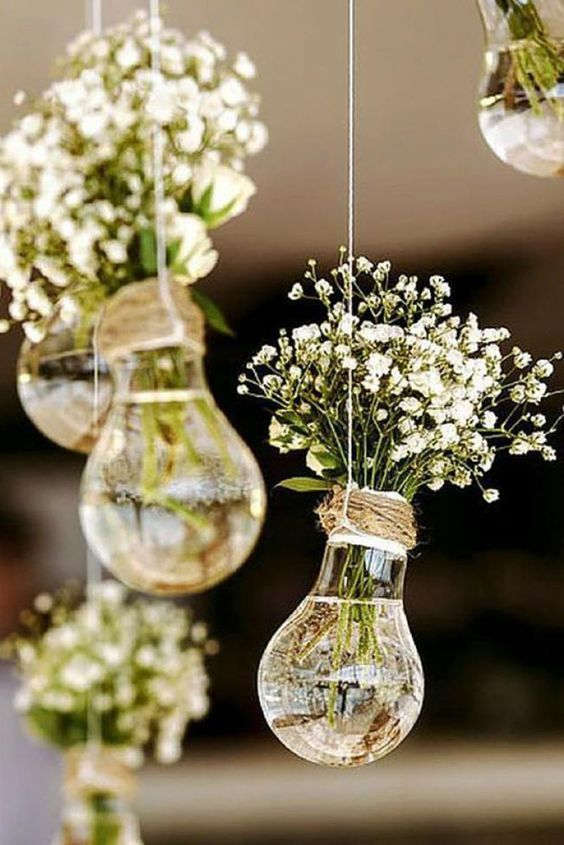 bulbs turned into little vases for baby's breath and hung as a wedding decoration