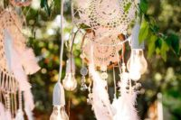 15 combine feathers, bulbs and macrame dreamcatchers for a boho chic wedding backdrop or decor