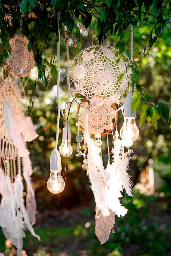 combine feathers, bulbs and macrame dreamcatchers for a boho chic wedding backdrop or decor