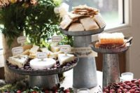 15 if it's a rustic dessert table, try galvanized steel stands and raw wood slices for displaying