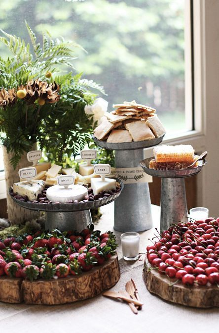 if it's a rustic dessert table, try galvanized steel stands and raw wood slices for displaying
