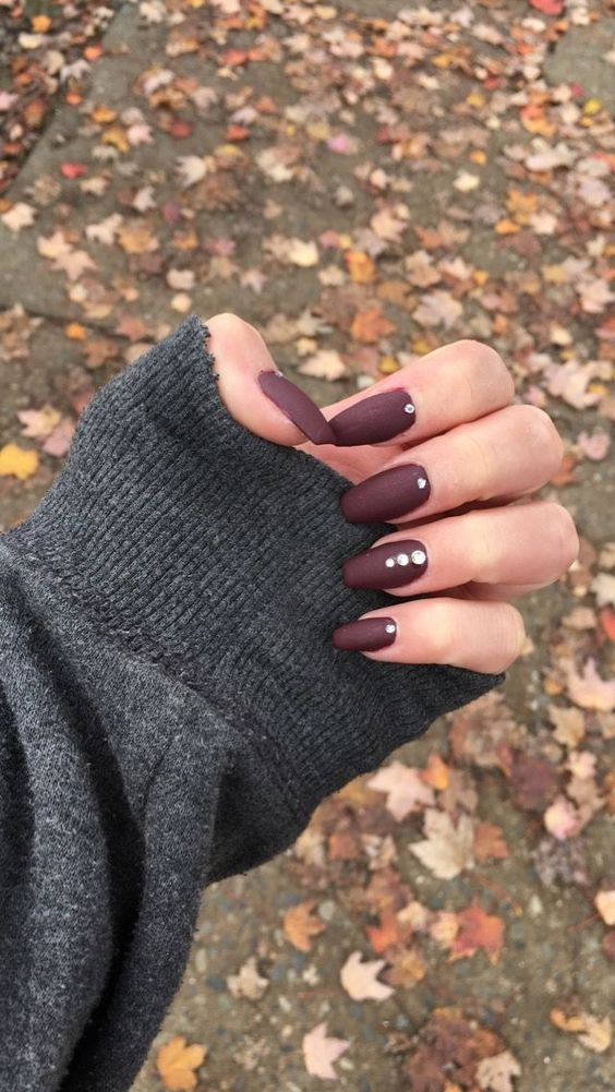 matte chocolate manicure spruced up with rhinestones is a chic and refined idea for a fall bride