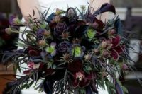 16 a burgundy, black and deep purple textural wedding bouquet with colorful greenery
