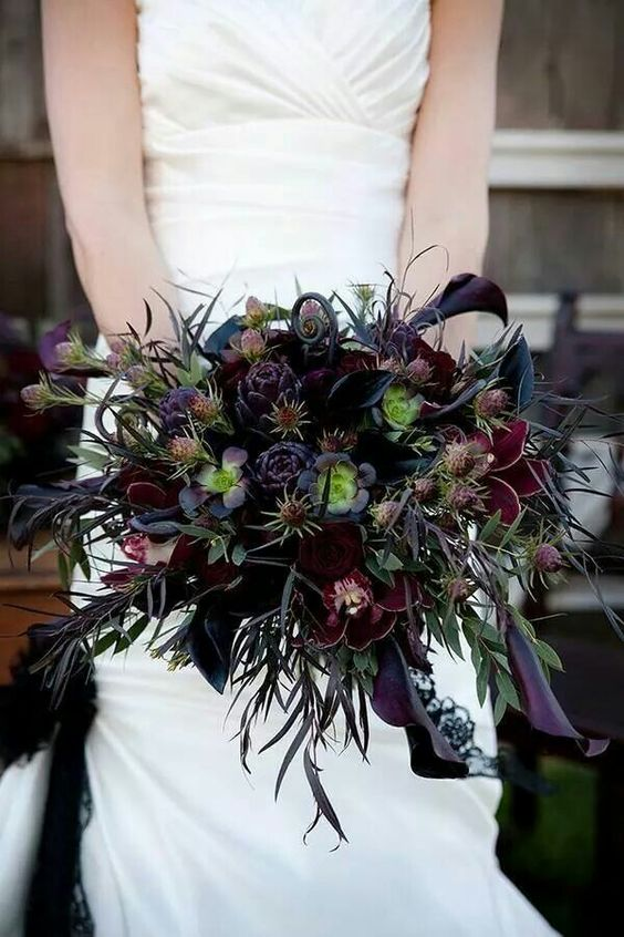 a burgundy, black and deep purple textural wedding bouquet with colorful greenery