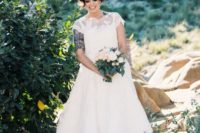 16 a chic vintage-inspired tea length lace wedding dress with an illusion neckline and grey strappy shoes