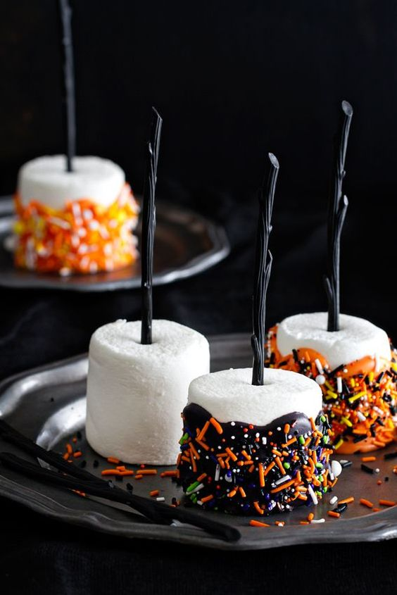 marshmallow pops with chocolate and colorful confetti are a delicious idea