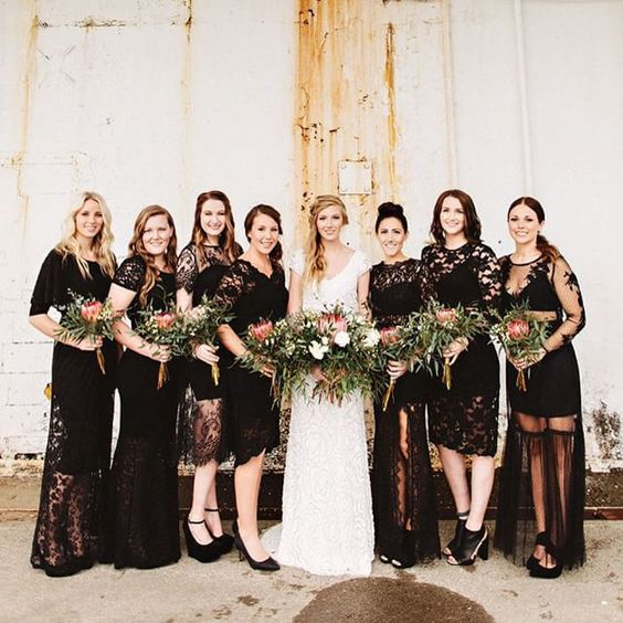 mismatching black lace bridesmaids' dresses and black shoes for a touch of rock