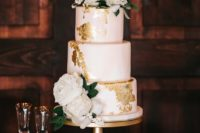 17 a blush wedding cake with gold foil and white blooms on top looks very cute and chic